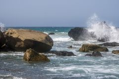 Beach with big stones in the surf. And dark sky Stock Photography