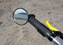 Beach through the bike mirror. Beach seen through the bike mirror royalty free stock photography