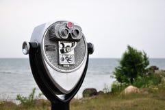 Beach Binoculars. Coin operated binoculars before Lake Ontario Stock Photos