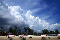 Beach in black clouds. China chinese beihai yintan beach black clouds umbrella Royalty Free Stock Photos