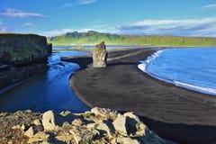 The beach with black volcanic sand Stock Photos