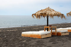 The beach with black volcanic stones at Santorini island Royalty Free Stock Image