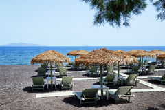 The beach with black volcanic stones at Santorini island Royalty Free Stock Photos