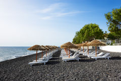 The beach with black volcanic stones at Santorini Royalty Free Stock Images