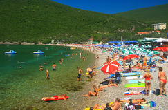 Beach with blue flag, Montenegro Stock Images