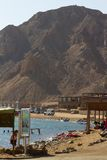 The beach at the Blue Hole, Dahab, Egypt. The beach at the Blue Hole, Dahab, Red Sea, Egypt, with the majestic mountains of the Sinai Peninsula in the background Stock Photo