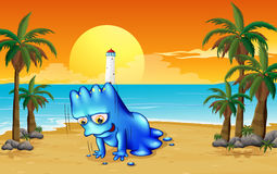 A beach with a blue monster Stock Photography
