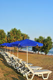 Beach with blue parasols Stock Photography