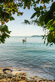 Beach and blue sea with tropical tree in morning light Royalty Free Stock Photos