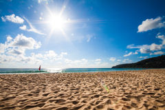 Beach and blue sky with flare Royalty Free Stock Photography