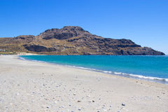 Beach with blue transparent water on Crete island in Greece Stock Photo
