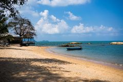 Beach with blue water, stones and boats in Pattaya, Thailand. 4K. royalty free stock photography