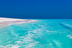 Beach and blue water Royalty Free Stock Photo