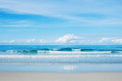 Beach and blue waves at sky. Sand beach and blue waves at the sky in summer stock photos