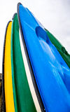 Beach Boards Close Up. Close up of beach boards, upended and stored ready for business of riding the waves Royalty Free Stock Photography