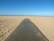 Beach Boardwalk. Leading to empty and sea Royalty Free Stock Image