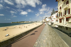 A beach boardwalk at St. Jean de Luz, on the Cote Basque, South West France, a typical fishing village in the French-Basque region Royalty Free Stock Image