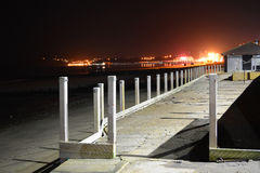 Beach Boardwalk and Town Lights. Board-walk at the beach with lights from the pier and Sandown Bay, Isle of Wight, in the background Stock Photography