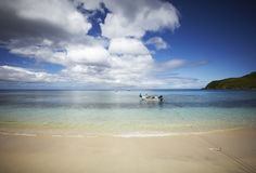Beach with a boat in a lagoon Royalty Free Stock Images
