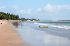 Beach with boat at low tide, Pititinga, Natal (Brazil). Beach with boat at low tide, wind farm in background, Pititinga, Natal (Brazil stock image