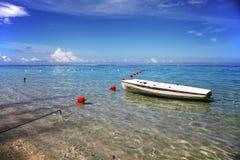 Beach and boat in Tahiti. Paradisiac island and coast in Polynesia Stock Photography