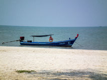 Beach. Boat thailand blue landscape sky nature tropical summer water paradise travel sea tourism ocean cloud sand coast bay wood asia beautiful fishing wave Royalty Free Stock Photos