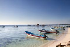 Beach and boats in Riviera Maya. Mexican beach and boats royalty free stock photography