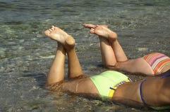 Beach body. Women on the beach Royalty Free Stock Image