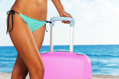Beach body  with pink suitcase Stock Image