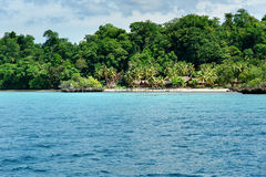 Beach on Bomba island. Togean Islands. Indonesia. Beautiful tropical beach on Bomba island. Togean Islands or Togian Islands in the Gulf of Tomini. Central Royalty Free Stock Image