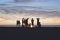 Beach bonfire at sunset Royalty Free Stock Image