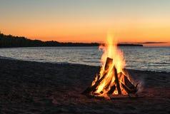 Beach Bonfire at Sunset Stock Photos