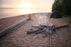 Beach Bonfire. With  Sunset Sky Stock Images