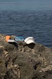 Beach and book. Objects of bath with a book posed at the edge of sea Stock Images