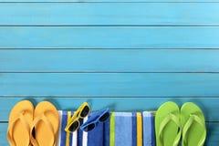 Summer beach background border flip flops sunglasses copy space Royalty Free Stock Photo