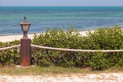 Beach border railing with rope Stock Photos