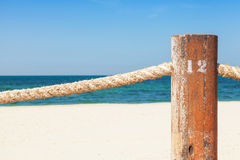 Beach border railing with rope Stock Photos