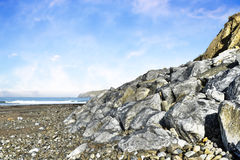 Beach and boulders at ballybunion Stock Photos