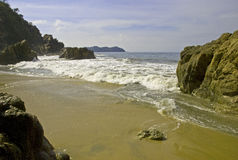 Beach and boulders by the Mexican Pacific Ocean royalty free stock image