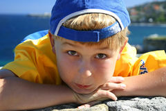 Beach boy. Bay at the beach, cap turned backwards Royalty Free Stock Photography