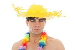 Beach boy with flower garland Stock Image