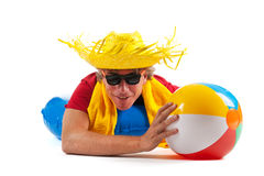 Beach boy with hat and toys Stock Images