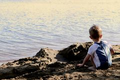 Beach Boy on the Lake Royalty Free Stock Photography