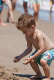 Beach Boy. Young Boy at the Beach playing in the sand Royalty Free Stock Photography