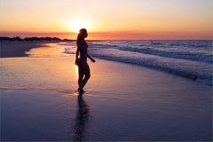 Beach Brazilian girl. Girl walking in the beach in sunset - North of Brazil Stock Image