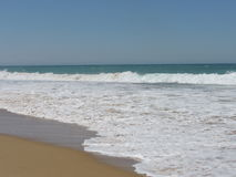 Beach with breaking wave. Wave breaking on a quiet beach stock images