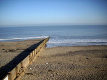 Beach, breakwater and sea Stock Images
