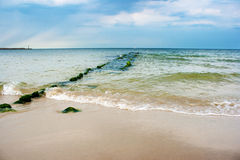 Beach with breakwater Stock Images