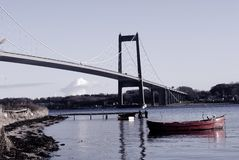 Beach, bridge and boat stock photography