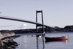 Beach, bridge and boat Stock Photography